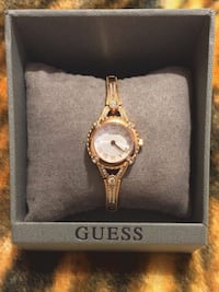 round gold analog watch with gold link bracelet South Houston, 77587
