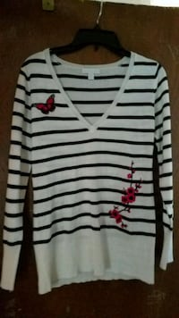 V-neck sweater with stripes, butterfly and flowers.  Essex, 21221