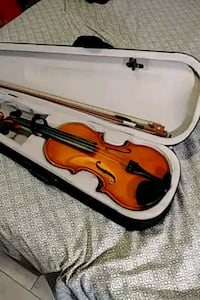 red violin with bow in case Fort Myers, 33919