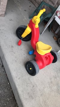 toddler's red and yellow trike 548 km