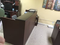 Classic wood reception desk with granite top