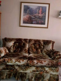brown and white floral fabric loveseat 773 mi