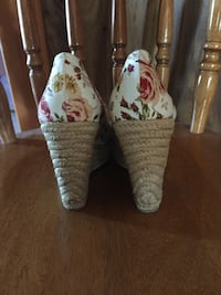 pair of white-and-red floral espadrille wedge sandals
