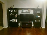 black wooden TV hutch. Minor scratches/wear/tear Jacksonville, 32218