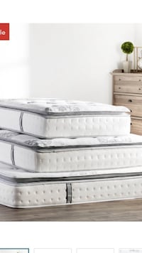 Three white quilted bed mattress