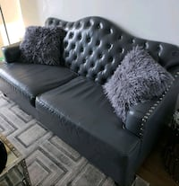 Grey leather tufted sofa with throw pillows Etobicoke, M8Y 0B5