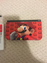 Black nintendo 3ds with game cartridge Markham, L3P 0R9