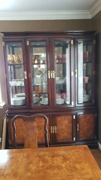brown wooden framed glass display cabinet Houston, 77004
