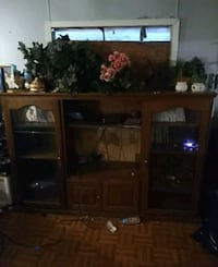 brown wooden TV hutch with flat screen television Pleasanton, 78064