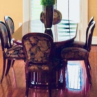 Solid rosewood table with 6 chairs.  Excellent condition! Bolton, L7E 2P5