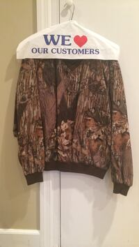 Mossy Oak and tan hunters attire