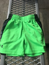 green and black Under Armour sport shorts