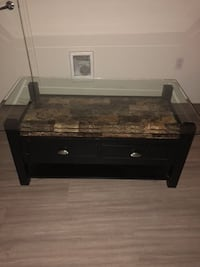 Brown wooden framed glass top coffee table Seattle, 98144