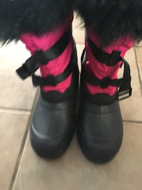 pair of pink-and-black fur-lined duck boots