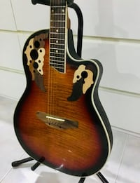 brown and black dreadnought acoustic guitar