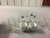 clear drinking glasses and two white ceramic mugs