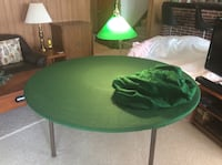 5' round folding table with 2 felt covers and a green hanging light Lexington Park