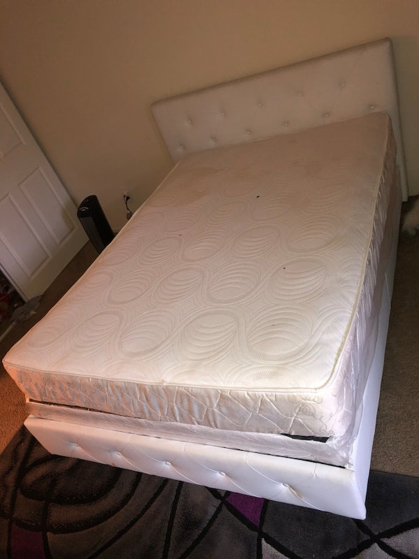 white mattress with white wooden bed frame