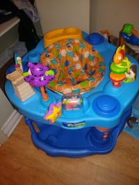 baby's blue and yellow activity saucer