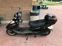 black and gray motor scooter 535 km