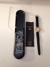 Round gold  guess analog watch with black leather