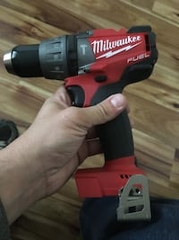red and black Milwaukee cordless impact wrench