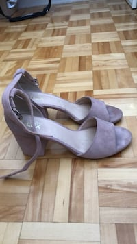 Pair of purple suede peep toe ankle strap wedges