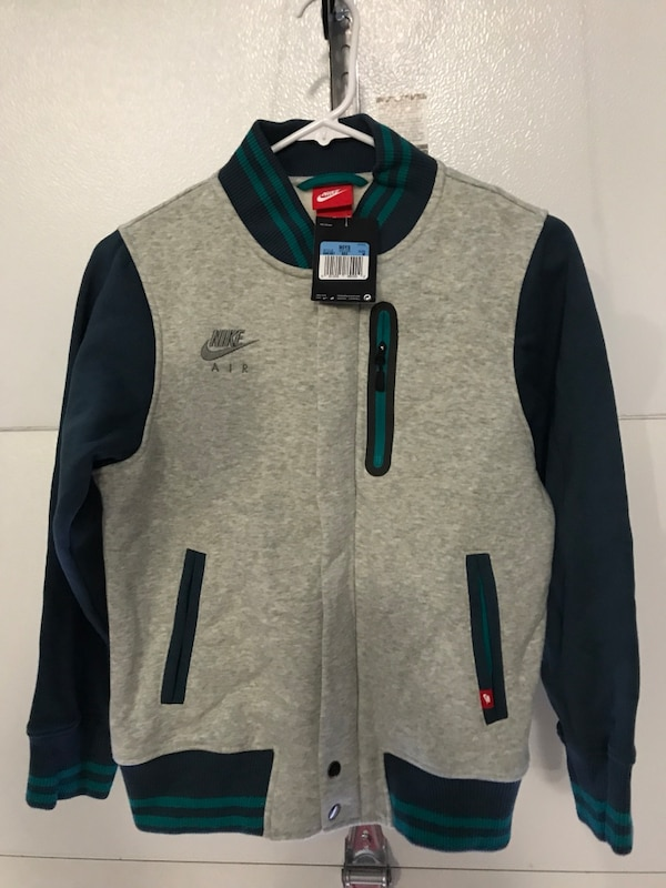gray, black and green Nike varsity jacket