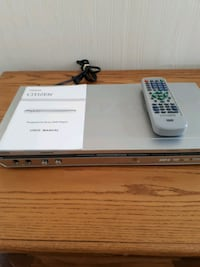 gray DVD player with remote
