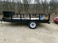 black and brown flatbed trailer Foley, 63347