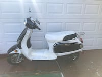 White and black motor scooter Miami, 33128
