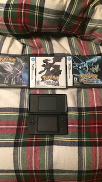 black Nintendo DS lite with game cases