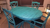 """Turquoise table and chairs w/Leaf . It's 48"""" across and the is 12"""", so with the Leaf it's 60"""". Not a huge table. I recovered the chairs with a black leather like material, two reg chairs and two captain chairs, It's beautiful! The pics do not do it justic Mustang, 73064"""