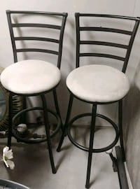 two black metal framed white padded chairs 344 mi