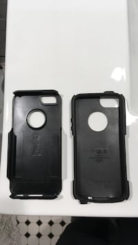 two black OtterBox iPhone cases