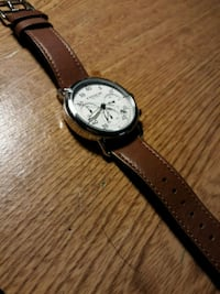 round silver analog watch with brown leather strap Alexandria, 22310