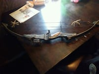 brown and black compound bow 217 mi