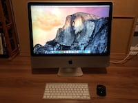 silver iMac with Apple Magic Keyboard and black mouse