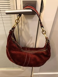 Authentic Coach cranberry red suede baguette.