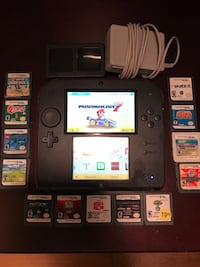 black Nintendo DS with game cartridges Stoneville, 27048