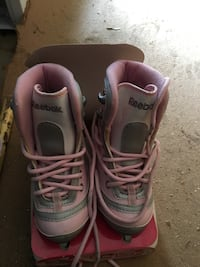 pair of white-and-pink Reebok athletic shoes