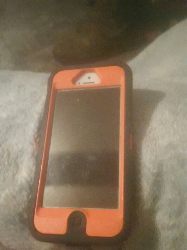 white iPhone 5 with orange and black case