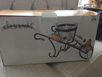 New- decorative wheel barrow with glass container Tiverton, 02878