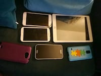 three assorted iPhone cases and black iPhone 4 Boston, 02131