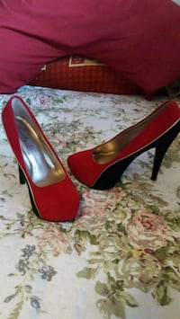 pair of red patent leather platform stilettos Calgary