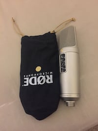 silver Rode wireless microphone with pouch