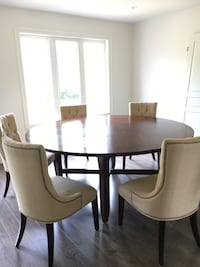 Round cherry veneer table with 6 chairs Niagara Falls, L2G 7T8