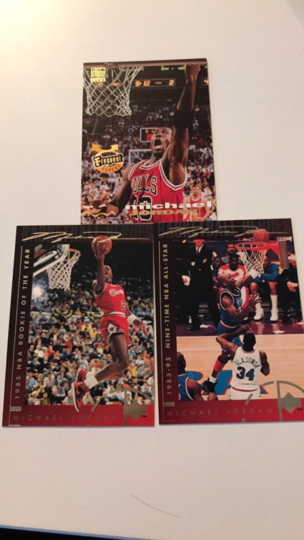 four assorted football trading cards