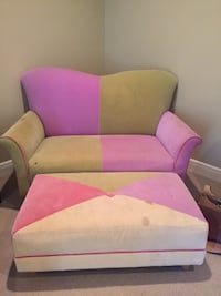 pink and white fabric sofa chair