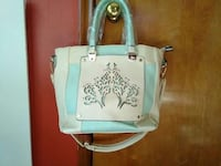 women's white and teal leather two way bag